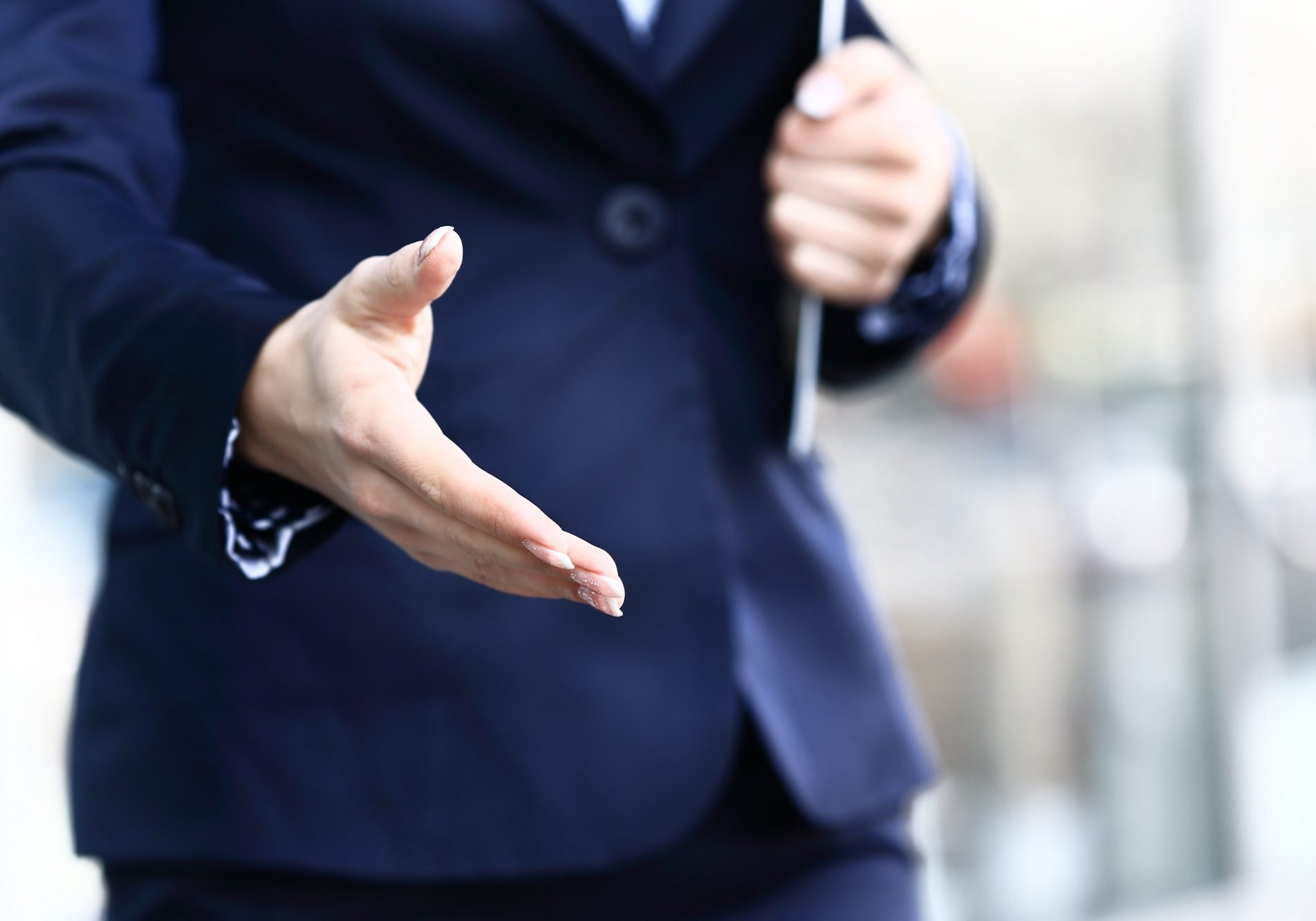 Businesswoman offer hand to handshake. in the office